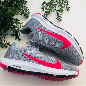 Nike gray and neon orange new running shoe…